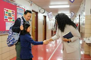 Ms. Cesar greeting TAG student